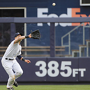 Jacoby Ellsbury, New York Yankees, catches a fly ball in the outfield during the New York Yankees V Baltimore Orioles home opening day at Yankee Stadium, The Bronx, New York. 7th April 2014. Photo Tim Clayton