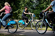 People on a Cycle Hire scheme bikes in Hyde Park, London. These Boris Bikes as they have become affectionately known are being widely used by local Londoners and tourists alike.