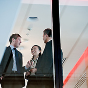 View from below of business man talking to colleagues