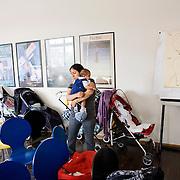 Milan, Italy, May 15th 2008. A South-American mother and her son at the babies group for immigrant mothers. Life Help Center C.A.V., Mangiagalli hospital...Milano, Italia, 15 maggio 2008. Una donna Sudamericana con il figlio durante un momento del gruppo bebè per mamme straniere al consultorio C.A.V. della clinica Mangiagalli.