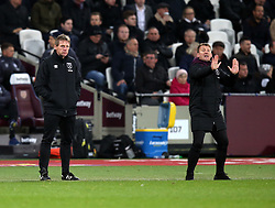 24 November 2017 London : Premier League Football : West Ham United v Leicester City - West Ham coaching staff strike differing poses : Stuart pearce keeps his hands in his pockets as Billy McKinlay directs the players.<br /> (photo by Mark Leech)