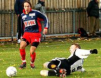 Fotball, 2. divisjon, RBK2 - Tromsdalen 0-5<br />Marius Lingrasmo, Tromsdalen, Kay Ivar Bjerkan, RBK2<br /><br /><br />Foto: Carl-Erik Eriksson, Digitalsport
