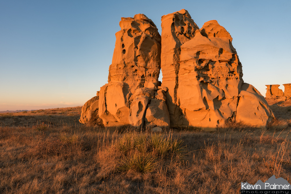 These bizarre sandstone rock formations rise up out of the eastern Montana prairie. They turned gold as the sun set.