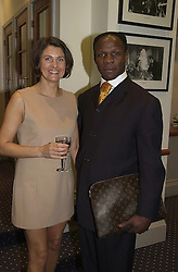 MR & MRS CHRIS EUBANK, he is the boxer, at a reception in London on 22nd February 2000.OBH  12