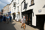 Richmond is a market town and the centre of the district of Richmondshire. Historically in the North Riding of Yorkshire, it is situated on the edge of the Yorkshire Dales National Park. North Yorkshire, England, UK. Local shops and streets just off Trinity Church Square.
