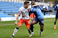 Luton Town forward James Collins (19) battles for possession withWycombe Wanderers midfielder Fred Onyedinma (23) during the EFL Sky Bet Championship match between Wycombe Wanderers and Luton Town at Adams Park, High Wycombe, England on 10 April 2021.