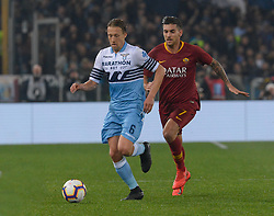 March 2, 2019 - Rome, Lazio, Italy - Lorenzo Pellegrini of AS Roma vies Lucas Leiva of SS Lazio during the Italian Serie A football match between S.S. Lazio and A.S Roma at the Olympic Stadium in Rome, on march 02, 2019. (Credit Image: © Silvia Lore/NurPhoto via ZUMA Press)
