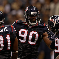 August 21, 2010; New Orleans, LA, USA; Houston Texans defensive end Mario Williams (90) talks to teammates Amobi Okoye (91) and DeMeco Ryans (59) during the first quarter of a preseason game against the New Orleans Saints at the Louisiana Superdome. Mandatory Credit: Derick E. Hingle