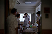 All the doctors and nurses of Aiwa Hospice participate ward rounds every morning and evening. They usually visit all the  ward asking patients condition. On August 25th, 2019 at Aiwa Hospice in Nagano, Japan.