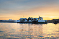 San Juan Islands Ferry approaching dock at sunrise in Guemes Channel Anacortes Washington