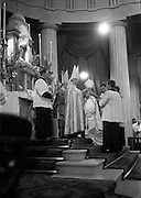 25/07/1962<br /> 07/25/1962<br /> 25 July 1962<br /> Consecration Rev. Dr Grimley S.M.A. as Bishop of Cape Palmas, Liberia at the Pro Cathedral, Dublin. Picture shows Most Very Rev. Dr. Richard Finn, S.M.A., Bishop of Ibidan, Nigeria, co-consecratory, placing his hands on the head of the new Bishop during the ceremony.