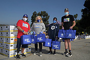 Jose Miranda (left), Los Angeles Dodgers external affairs and Dodgers community relations vice president Naomi Rodriguez (second from left), Dodgers Foundation chief executive officer Nichol Whiteman (second from right) and No Vet Left Alone/Life Aid Research founder John Wordin pose during LADF 16th annual Thanksgiving Turkey Giveaway at Dodger Stadium, Thursday, Nov. 19, 2020, in Los Angeles.