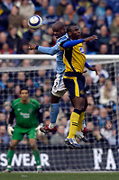 Photo: Jed Wee.<br />Manchester City v Wigan Athletic. The Barclays Premiership. 18/03/2006.<br /><br />Manchester City's David Sommeil (L) jumps with Wigan's Jason Roberts.