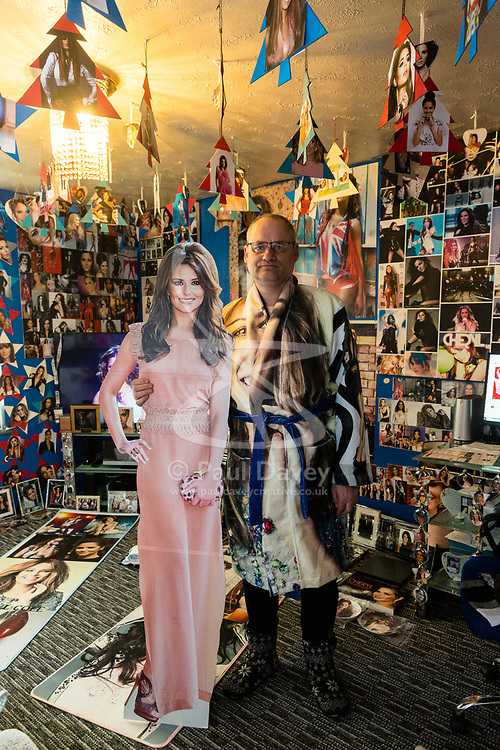 Shaun Smith, 52, from Basildon in Essex poses with a cut-out of his idol in his sitting room. He has built up a huge £7,000 collection of Cheryl Cole memorabilia in the space of about eight months after she impressed him in a music video he was watching.. PLACE, January 24 2019.