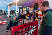 Prudence Salinas and her father Travis Ackerman play lawn games at at the AARP Block Party at the Albuquerque International Balloon Fiesta in Albuquerque New Mexico USA on Oct. 7th, 2018.