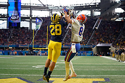 Michigan Wolverines defensive back Brandon Watson #28 breaks up a pass intended for Florida Gators wide receiver Trevon Grimes #8 during the Chick-fil-A Peach Bowl, Saturday, December 29, 2018, in Atlanta. ( Paul Abell via Abell Images for Chick-fil-A Peach Bowl)
