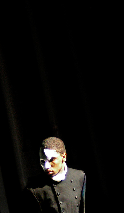 """The theme for Laurel High's Fashion Battle show, """"Resurrection,"""" is highlighted by a Phantom of the Opera-like character played by Michael Johnson. ..Reigning Fashion Battle Champs, Laurel High School, hand over the crown during the 2nd annual contest held at the University of Maryland College Park's Tawes Theatre Saturday January 15, 2005."""