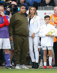 Katie Price kisses son Harvey as she is a football manager and manages a team in the 'Smile for Joel' and 'Compton Hospice' charities celebrity football match at the Bescot Stadium, Walsall. Katie arrived over thirty minutes late for the event.<br /><br />13 May 2017.<br /><br />Please byline: Headlinephoto/Vantagenews.com
