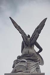 Statue of angel on Schlossbrucke bridge designed by  Karl Friedrich Schinkel in Mitte, Berlin, Germany