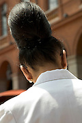 woman with big hair knot