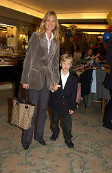 LUCY SANGSTER wife of Ben Sangster and her son OLIVER SANGSTER at a children's party in aid of the charity Over The Wall held at Fortnum & Mason, Piccadilly, London before a gala premiere of the new musical Mary Poppins at The Prince of Wales Theatre, Old Compton Street, London W1<br /><br />NON EXCLUSIVE - WORLD RIGHTS