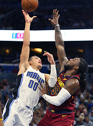 October 13, 2017 - Orlando, FL, USA - The Orlando Magic's Aaron Gordon (00) scores over the Cleveland Cavaliers' Jae Crowder in preseason action at the Amway Center in Orlando, Fla., on Friday, Oct. 13, 2017. (Credit Image: © Stephen M. Dowell/TNS via ZUMA Wire)
