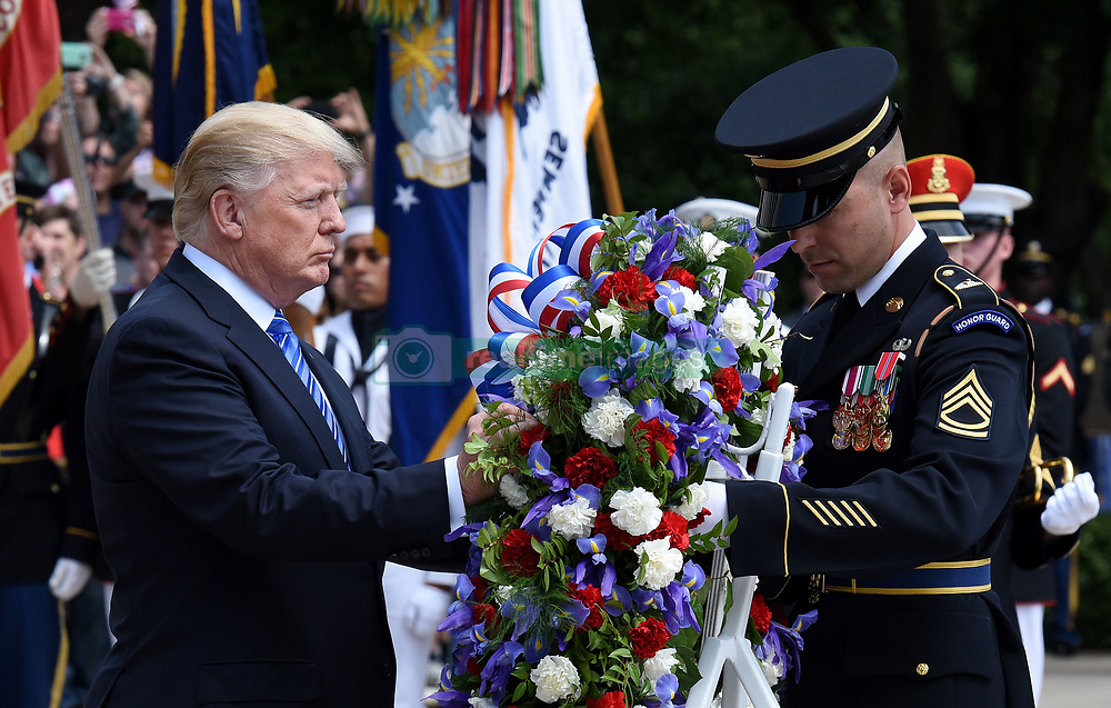 President Donald Trump attends the Arlington National Cemetery on Memorial Day in Arlington, Virginia. 29 May 2017 Pictured: President Donald Trump attends the Arlington National Cemetery on Memorial Day. Photo credit: Ron Sachs / CNP / MEGA TheMegaAgency.com +1 888 505 6342