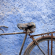 Detail of old bicycle and textured wall in blue city of Jodhpur