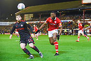 Dimitri Cavare of Barnsley (12) chases down Lynden Gooch of Sunderland (11) during the EFL Sky Bet League 1 match between Barnsley and Sunderland at Oakwell, Barnsley, England on 12 March 2019.