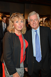 SIR NICHOLAS & LADY LLOYD at a party to celebrate the publication of 'Feeding The Future' by Lohralee Astor and Tali Shine held at OKA, 155-167 Fulham Road, London on 8th June 2016.