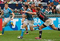 HONG KONG, HONG KONG : Rob Vickerman of England goes for the score as Nick Hewson of Hong Kong tries to bring him down, in England's  42-7 win in the Bowl Final, at the Hong Kong Rugby Sevens, shown in Hong Kong on Sunday, 24 March, 2013.