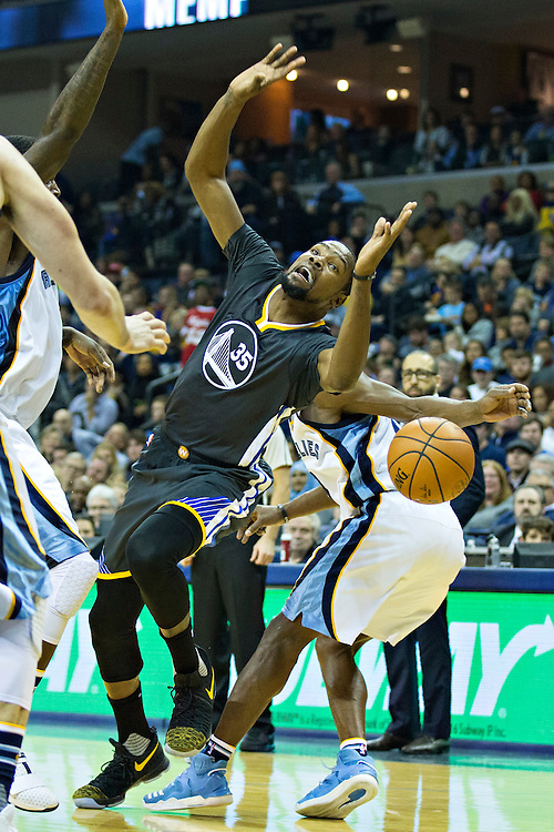 MEMPHIS, TN - DECEMBER 10:  Kevin Durant #35 of the Golden State Warriors is fouled on the floor during a game against the Memphis Grizzlies at the FedExForum on December 10, 2016 in Memphis, Tennessee.  The Grizzlies defeated the Warriors 110-89.  NOTE TO USER: User expressly acknowledges and agrees that, by downloading and or using this photograph, User is consenting to the terms and conditions of the Getty Images License Agreement.  (Photo by Wesley Hitt/Getty Images) *** Local Caption *** Kevin Durant