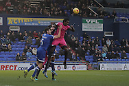 Southend United striker Nile Ranger (50) gets ahead of Oldham Athletic defender Cameron Burgess (5) during the EFL Sky Bet League 1 match between Oldham Athletic and Southend United at Boundary Park, Oldham, England on 17 December 2016. Photo by Simon Brady.