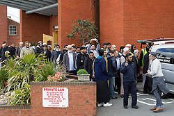 © Licensed to London News Pictures . 22/05/2013 . Bolton , UK . People leave the Zakaria Mosque following the service . Burial prayers for Baby Alia today (Wednesday 22nd May) whose body was discovered abandoned shortly before 4.55pm on Thursday March 14 in Ox Hey Lane , Lostock , near Bolton , by a man and woman out walking their dog . She was wrapped in clothes and a carrier back with a note requesting an Islamic burial . Police say the girl was born alive . They are yet to identify who her mother is . Photo credit : Joel Goodman/LNP