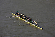A boat from the Oxford University rowing team rounds the bend of the River Thames in Putney, West London during a winter training session. First raced in 1829 the boat race between Oxford and Cambridge unbiversities is one of the oldest sporting events in the world. It is nowadays watched by thousands along the banks of The Thames Tideway, between Putney and Mortlake in London and by millions more on TV around the world.