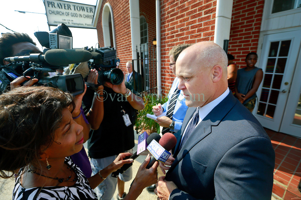 14 September 2013. Prayer Tower Church of God in Christ. New Orleans, Louisiana. <br /> Mayor Mitch Landrieu attends the funeral for 11 yr old Arabian 'Ray Ray' Gayles, fatally shot September 2nd. Arabian was cradling a 1 yr old cousin whilst sat on the couch at home when gunmen pulled up outside and sprayed the house with bullets. Arabian was hit in the head and died shortly afterwards. NOPD is questioning 2 men in connection with the murder.<br /> Photo; Charlie Varley