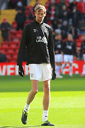 Burnley's Peter Crouch warms up ahead of the Premier League match at Anfield, Liverpool.