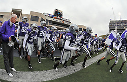 Nov 14, 2009; Manhattan, KS, USA; Kansas State head coach Bill Snyder (left) head onto the field with his team before the game against the Missouri Tigers at Bill Snyder Family Stadium. The Tigers won 38-12. Mandatory Credit: Denny Medley-US PRESSWIRE