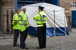 © Licensed to London News Pictures . 20/09/2015 . Manchester , UK . Police forensic tent on Brazil Street , central Manchester , where Greater Manchester Police are responding to a report that two girls , aged 15 and 17 years old respectively , have been raped . The incident is alleged to have taken place yesterday afternoon (19th September 2015) . Photo credit : Joel Goodman/LNP