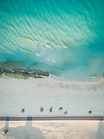 Aerial view of an empty road on the beach of Corralejo Dunes Natural Park in Fuerteventura, Canary Islands.