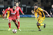 Jennison Myrie-Williams of Newport County and Kallum Mantack of Alfreton Town during the The FA Cup match between Newport County and Alfreton Town at Rodney Parade, Newport, Wales on 15 November 2016. Photo by Andrew Lewis.