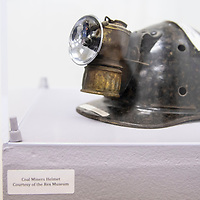 """A coal miners helmet from the Rex Museum, at the """"Limb, Life and Bread on Mining in New Mexico Exhibit,"""" Wednesday, Oct. 17, 2018 at the University of New Mexico-Gallup."""