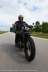 Artist Jeff Durrant riding his 1942 Harley-Davidson WLC bobber in the Cross Country Chase motorcycle endurance run from Sault Sainte Marie, MI to Key West, FL (for vintage bikes from 1930-1948). Stage 2 from Ludington, MI to Milwaukee, WI, USA. Saturday, September 7, 2019. Photography ©2019 Michael Lichter.