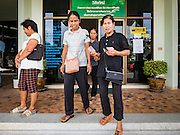 15 DECEMBER 2016 - PRACHINBURI, THAILAND: People leave a government credit union in Prachinburi, Thailand after picking up their cash disbursements. The Thai government said people who earn 30,000 Baht (about $857 US) or less per year are entitled to a 3,000 Baht cash payment (about $85.7 US) and those who earn 30,000 Baht to 100,000 Baht (about $2,857 US) per year are entitled to a 1,500 Baht (about $42.8 US) cash payment. The plan is meant to help low income people, especially the rural poor. Government banks in rural areas offering the disbursement have been crowded with people seeking their payments this week.      PHOTO BY JACK KURTZ   Social Safety Net