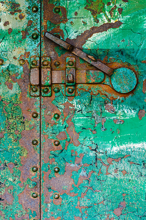 Rusty exterior door of an abandoned WWII bunker, April, afternoon light, Fort Worden State Park, Jefferson County, Olympic Peninsula,  Washington, USA