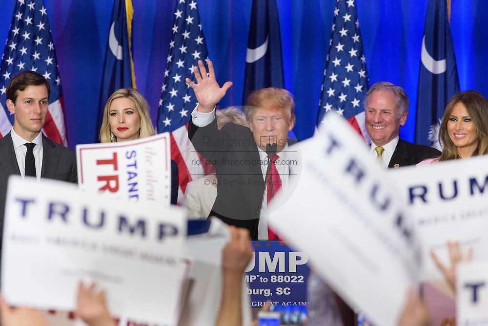 Billionaire and GOP presidential candidate Donald Trump waves to cheering supporters alongside wife Melania, daughter Ivanka and Lt. Gov. Henry McMasters as they celebrate victory in the South Carolina Republican primary February 20, 2016 in Spartanburg, South Carolina, USA .