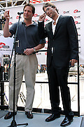 Kevin Federline, (right) husband of the famous singer Britney Spears, is holding a Penny coin moments after having signed a petition in collaboration with Virgin, during a Virgin Mobile promotion event at Time Square, New York, on Wednesday, June 21, 2006. The petition against the abolition of the Penny coin, sponsored by Virgin Mobile, will be then sent over to lawyers in Washington. After this extraordinary event, Virgin Mobile will allow customers to buy 1000 text messages a month for only $9.99, just one humble penny per text.  **ITALY OUT**