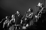 """Slaid Cleaves, Eliza Gilkyson, Jimm LaFave, Radislav Lorkovic, Sarah Lee Guthrie, Jimmy Irions comprise the ensemble,""""Walking Woody's Road,"""" a tribute to the iconic folksinger Woody Guthrie at the Sisters Folk Festival."""