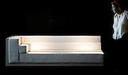 V. 02. Valencia, 27/09/2004. Una mujer contempla un sofa expuesto en la Feria Internacional del Mueble (FIM) que ha  abierto hoy sus puertas, con la participación de dos mil empresas en los cerca de 150.000 metros cuadrados de superficie de exposición. EFE/Kai Försterling.