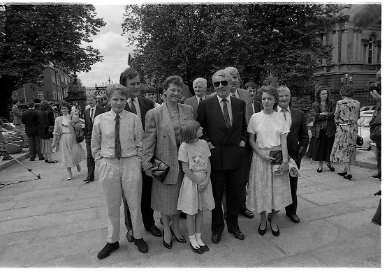 Dail Resumes After General Election.  (T3)..1989..29.06.1989..06.29.1989..29th June 1989..After the general election  members of the 26th Dáil arrived in Leinster House, Dublin to take their seats in the parliamentary chamber...Austin Currie TD is pictured arriving at Dáil Éireann to take up his seat in the Dáil.Here he is pictured with family and friends in the grounds of Leinster House.
